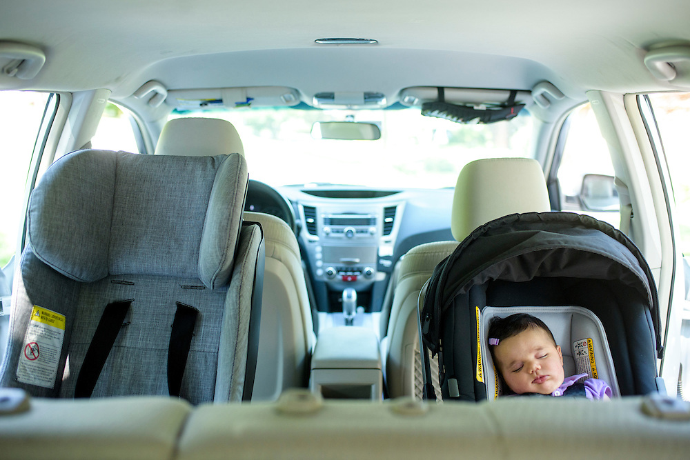 Pikesville, Maryland - June 25, 2015:  Car Seat Lady Alisa Baer's niece demonstrates the preferred way to seat children in a car, back-facing. <br /> <br /> Seven-week-old Leora Aghion sits in a Nuna Pipa infant seat ($300), outside their house in Pikesville, Maryland. <br /> <br /> Alisa Baer, 35, and Emily Levine, 34, both from Manhattan and Alisa's mother Deborah Baer, 67, from Pikesville, Maryland operate The Car Seat Lady blog and car seat installation classes available in New York and Maryland. <br /> <br /> CREDIT: Matt Roth for The New York Times<br /> Assignment ID: 30176354A