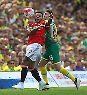 Ivo Pinto of Norwich and Memphis Depay of Manchester United in action during the Barclays Premier League match at Carrow Road, Norwich<br /> Picture by Paul Chesterton/Focus Images Ltd +44 7904 640267<br /> 07/05/2016