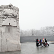 A ranger provides information to a group fo tourists at the Martin Luther King Memorial on the banks of the Tidal Basin in Washington DC on a cold, misty winter's morning.