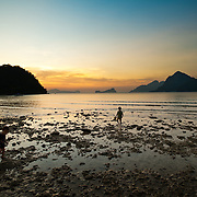 Children play in tropical intertidal zone in Palawan, Philippines