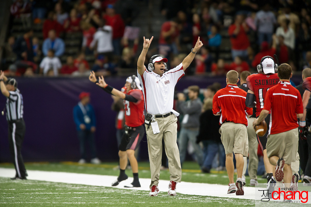 Louisiana-Lafayette's coach, Jorge Munoz, celebrates during the R+L Carriers New Orleans Bowl at the Mercedes-Benz Superdome.  Louisiana-Lafayette defeated San-Diego State 32-30. (Copyright Michael Chang)