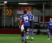 Chesterfield Defender Ian Evatt heads clear during the The FA Cup match between FC United of Manchester and Chesterfield at Broadhurst Park, Manchester, United Kingdom on 9 November 2015. Photo by Pete Burns.