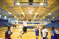 Shelby McEwen dunks as the Charger basketball team uses the new gym at Oxford High School for the first time, in Oxford, Miss. on Thursday, March 27, 2014.