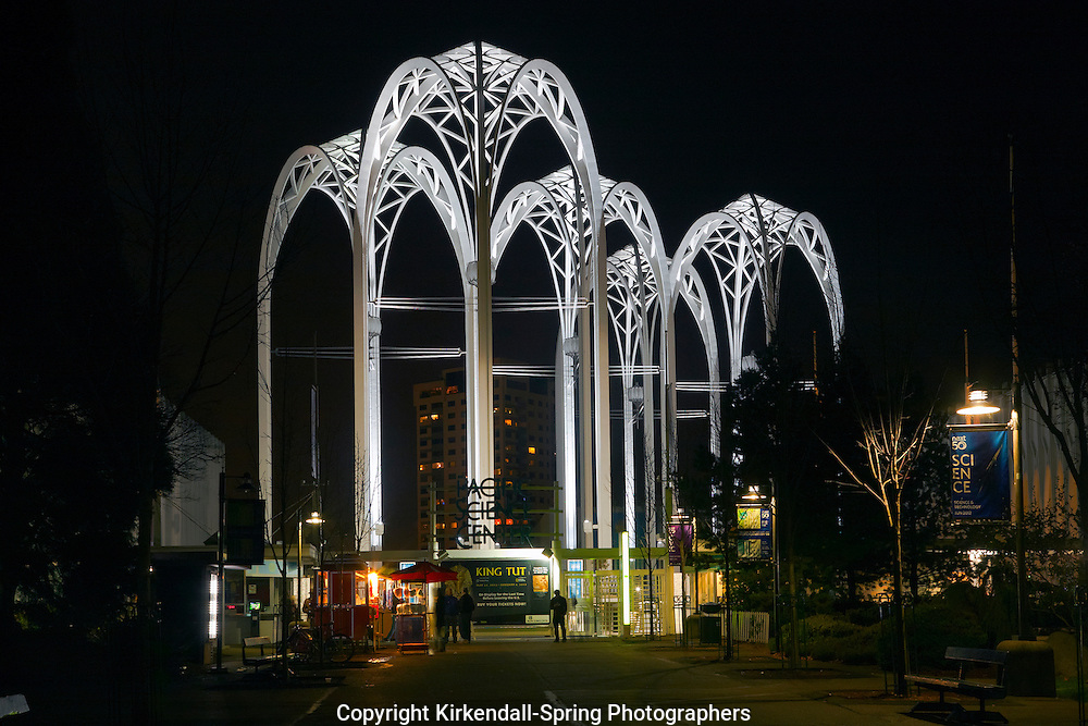 WA07871-00...WASHINGTON - Night time view of the Arches at the entrance to the Pacific Science Center at the Seattle Center in downtown Seattle.