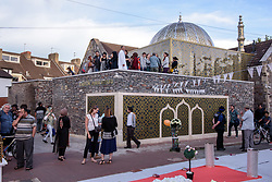 © Licensed to London News Pictures.  22/06/2017; Bristol, UK. The Easton Jamia Masjid Mosque at 'The Big Iftar 2017' in St Marks Road, Easton, Bristol, marking the end of the muslim holy month of Ramadan when muslims fast from dawn until sunset. It is believed this is the first time in the UK that the event includes a meal held in the street and shared with all communities including non-muslims. It is hosted by Easton Jamia Masjid with partners including Bristol4Muslims, we care foundation, Karam Kitchen, and aims to bring people from different backgrounds and cultures together to share good food and learn from each other. Ramadan is a month of sharing, hospitality, charity giving and creating new friendships, and the Big Iftar is a great way of achieving these goals while breaking down barriers that may exist within communities. Visitors were also given a grand tour to the newely refurbished mosque located in the heart of Easton. Picture credit : Simon Chapman/LNP