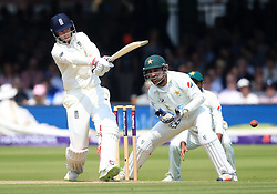 England's Joe Root hits the ball away during day three of the First NatWest Test Series match at Lord's, London.