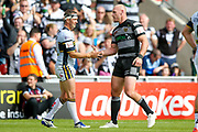 Leeds Rhinos scrum half Danny McGuire (6) shakes hands with Hull FC loose forward and captain Gareth Ellis (13) after the game during the Challenge Cup 2017 semi final match between Hull RFC and Leeds Rhinos at the Keepmoat Stadium, Doncaster, England on 29 July 2017. Photo by Simon Davies.