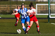 Brighton's Jay Blackie tussles with Charlton's Kit Graham during the FA Women's Premier League Cup quarter-final match between Brighton Ladies and Charlton Athletic WFC at The American Express Elite Football Performance Centre, Lancing, United Kingdom on 1 March 2015. Photo by Geoff Penn.