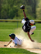 Shortstop Mike Daley of Immaculata makes the force at second as Shane Alverez (1) of  St. Joseph High School tries to break-up the double play.