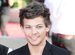 © Licensed to London News Pictures. 20/08/2013, UK. Louis Tomlinson, One Direction: This Is Us - World film premiere, Leicester Square, London UK, 20 August 2013<br />  Photo credit : Richard Goldschmidt/Piqtured/LNP