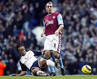 Photo: Chris Ratcliffe.<br />Tottenham Hotspur v Aston Villa. The Barclays Premiership. 21/01/2006.<br />Gavin McCann (R) of Villa is tackled by Edgar Davids of Spurs .