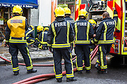 London Fire Brigade firefighters respond to an explosion in a small shop o Church Street, Stoke Newington, London, United Kingdom.  They have been called out due to a large explosion in the basement of a shop.  The London Fire Brigade is the 4th largest fire-service in the world.