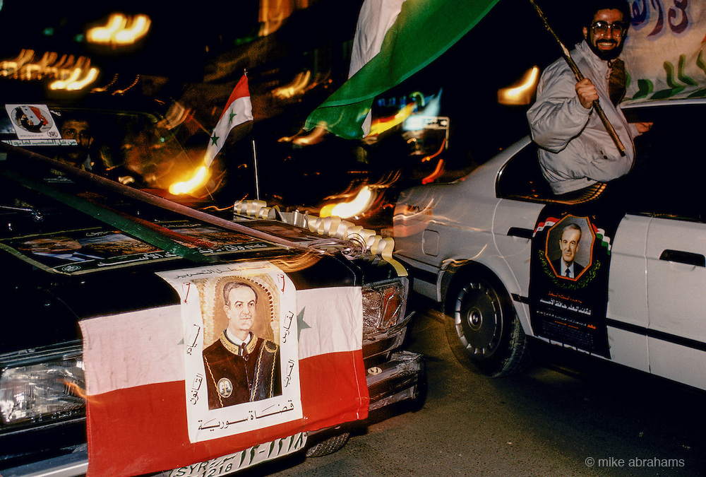 'PERSONALITY CULT OF ASSAD', MEN DRIVING & HANGING OUT OF THE WINDOWS OF CARS DECORATED WITH PICTURE OF ASSAD DURING THE REFURENDUM CAMPAIGN, DAMASCUS, DECEMBER 1991