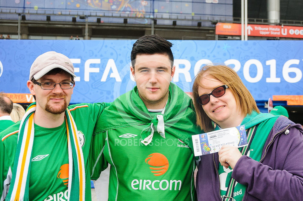 Ireland fans with a prized ticket. Action from the IRELAND v SWEDEN UEFA EURO 2016 game at Stade de France in St Denis, 13 June 2016. (c) Paul J Roberts / Sportpix.org.uk