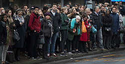 © Licensed to London News Pictures. 09/01/2017. London, UK. Commuters wait patiently for buses near Waterloo Station as a 24 hour London Underground tube strike takes hold.  All Zone one tube stations are closed until 6PM tonight after members of the RMT and the Transport Salaried Staffs' Association unions walked out after talks with TFL collapsed.  Photo credit: Peter Macdiarmid/LNP