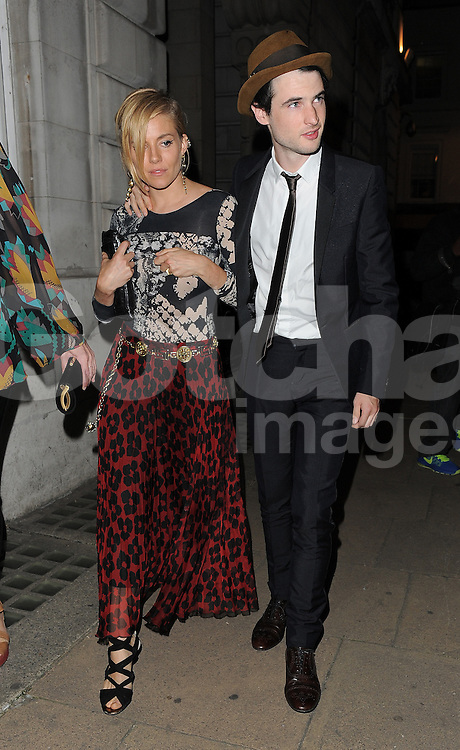Actress Sienna Miller and Tom Sturridge arriving at the LFW AnOther Magazine party at Loulou's private members club in Mayfair, London, UK. 15/09/2014<br />BYLINE MUST READ : GOTCHAIMAGES.COM<br /><br />Copyright by &copy; Gotcha Images Ltd. All rights reserved.<br />Usage of this image is conditional upon the acceptance <br />of Gotcha Images Ltd, terms and conditions available at<br />www.gotchaimages.com