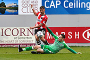 Kane Wilson (22) of Exeter City is tackled by Chris Hussey (3) of Swindon Town during the EFL Sky Bet League 2 match between Exeter City and Swindon Town at St James' Park, Exeter, England on 24 March 2018. Picture by Graham Hunt.