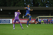 Lyle Taylor AFC Wimbledon and Kelvin Mellor during the Johnstone's Paint Trophy match between AFC Wimbledon and Plymouth Argyle at the Cherry Red Records Stadium, Kingston, England on 1 September 2015. Photo by Stuart Butcher.