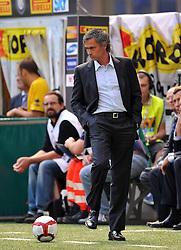 Inter Milan coach Jose Mourinho kicks the ball. Inter Milan v Parma, San Siro, Milan, 13th September 2009.