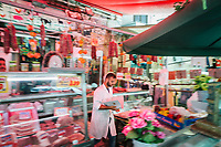 NAPLES, ITALY - 13 JULY 2017: A meat vendor is seen here at the Porta Capuana market in Naples, Italy, on July 13th 2017.