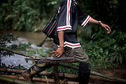 An FDLR soldier in the jungles of North Kivu, DRC, on Sunday, March. 16, 2008..The FDLR comprises Hutu extremists who fled Rwanda after their involvement in the 1994 genocide, as well as Hutu members of the former Rwandan army and a mix of displaced Rwandan Hutus. Numbering approximately 10,000, they have lived in the jungles of DRC for the past 14 years and in that time have resisted repeated calls for disarmament and repatriation..