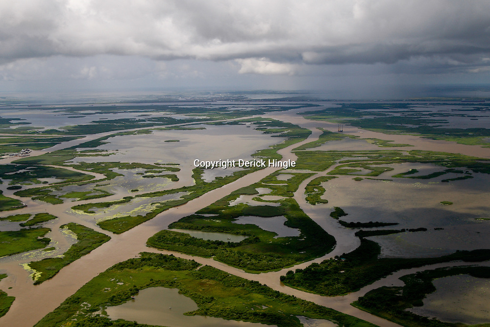 Canals created for navigation and oil and gas pipelines are seen in marsh over the coast of Louisiana, U.S., on Monday, July 26, 2010. Photographer: Derick E. Hingle