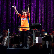 July 13, 2013 - New York, NY : Alan Gilbert addresses the audience as he leads<br /> The New York Philharmonic in the free MLB All-Star Charity Concert to benefit Hurricane Sandy victims, in Central Park's great lawn on July 13, 2013. Pop star Mariah Carey (not pictured) made a guest appearance. <br /> CREDIT: Karsten Moran for The New York Times