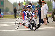 July 4th, 2006:  Anchorage, Alaska - Bradley Gomoluch, a Marine Corps veteran from Saginaw, Michigan, enters turn one in the 5k Handcycle race at the 26th National Veterans Wheelchair Games.