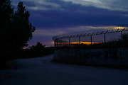 Barbed wire fence at sunset Photographed on Cephalonia, Ionian Islands, Greece