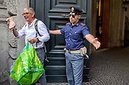 Roma 10 Settembre 2014<br /> Flash mob del sindacato USB Pubblico Impiego,  davanti al ministero  della Funzione Pubblica, i manifestanti hanno lasciato 30 chili di grasso animale, davanti all'ingresso del ministero , per protestare contro le dichiarazioni del Presidente del Consiglio Matteo Renzi che in un intervista dichiarava che nella pubblica amministrazione c'&egrave;  &quot;C'&egrave; troppo grasso che cola nella  pubblica amministrazione&quot;. Un manifestante viene fermato da un poliziotto all'ingresso del ministero<br /> Rome September 10, 2014 <br /> Flash mob syndicate USB Public Employment, in front of the Ministry of Public Administration, the protesters left 30 pounds of animal fat, in front of the entrance to the Ministry, to protest against the statements of the President of the Council Matteo Renzi, who during  interview stated that  &quot;There is too much fat that drips into the  public administration &quot; . A protester is stopped by a policeman at the entrance of the Ministry