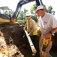 Adam Robison | BUY AT PHOTOS.DJOURNAL.COM<br /> Justin Cooley, an employee for Atmos Energy, and Wayne Kelly, an employee for Tupelo Water and Light, work to remove an unsed telephone line fron under ground at the West Jackson Street neighborhood site Tuesday morning in Tupelo.