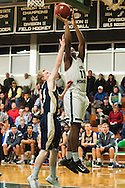 Rice;s Ben Shungu (11) leaps over Essex's Peter Barrows (15) for a lay up during the boys basketball game between the Essex Hornets and the Rice Green Knights at Rice Memorial high school on Tuesday night December 22, 2015 in South Burlington.(BRIAN JENKINS/for the FREE PRESS)