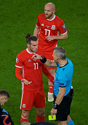 CARDIFF, WALES - Sunday, October 13, 2019: Wales' captain Gareth Bale speaks with referee Björn Kuipers during the UEFA Euro 2020 Qualifying Group E match between Wales and Croatia at the Cardiff City Stadium. (Pic by Paul Greenwood/Propaganda)
