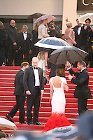 Cheryl Cole gets shelter from the rain on the red steps,  attending the gala screening of Amour at the 65th Cannes Film Festival. Sunday 20th May 2012 in Cannes Film Festival, France.