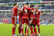Middlesbrough FC midfielder Albert Adomah celebrates the second goal during the Sky Bet Championship match between Brighton and Hove Albion and Middlesbrough at the American Express Community Stadium, Brighton and Hove, England on 19 December 2015. Photo by Phil Duncan.
