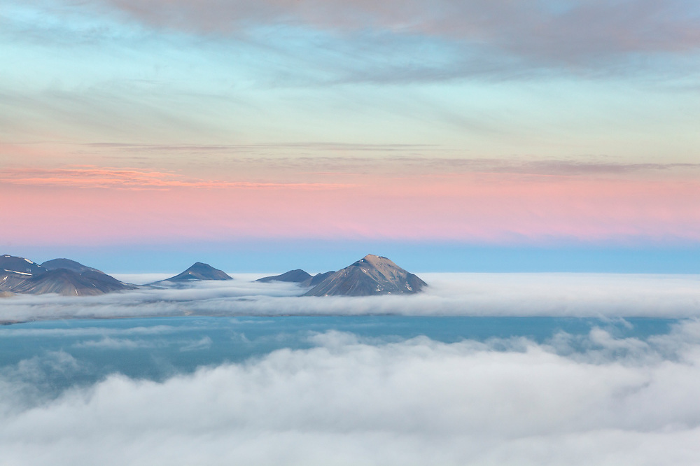 Low clouds approach the coast from the Greenland Sea, seen from high on Ariekammen, Hornsund, Svalbard.