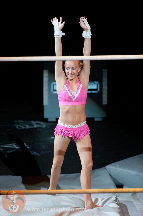 Sep 21, 2008; San Jose, CA, USA; Nastia Liukin performs on the uneven bars during the 2008 Tour of Gymnastics Superstars post-Beijing Olympic tour at HP Pavilion in San Jose, CA. Mandatory Credit: Kyle Terada-Terada Photo