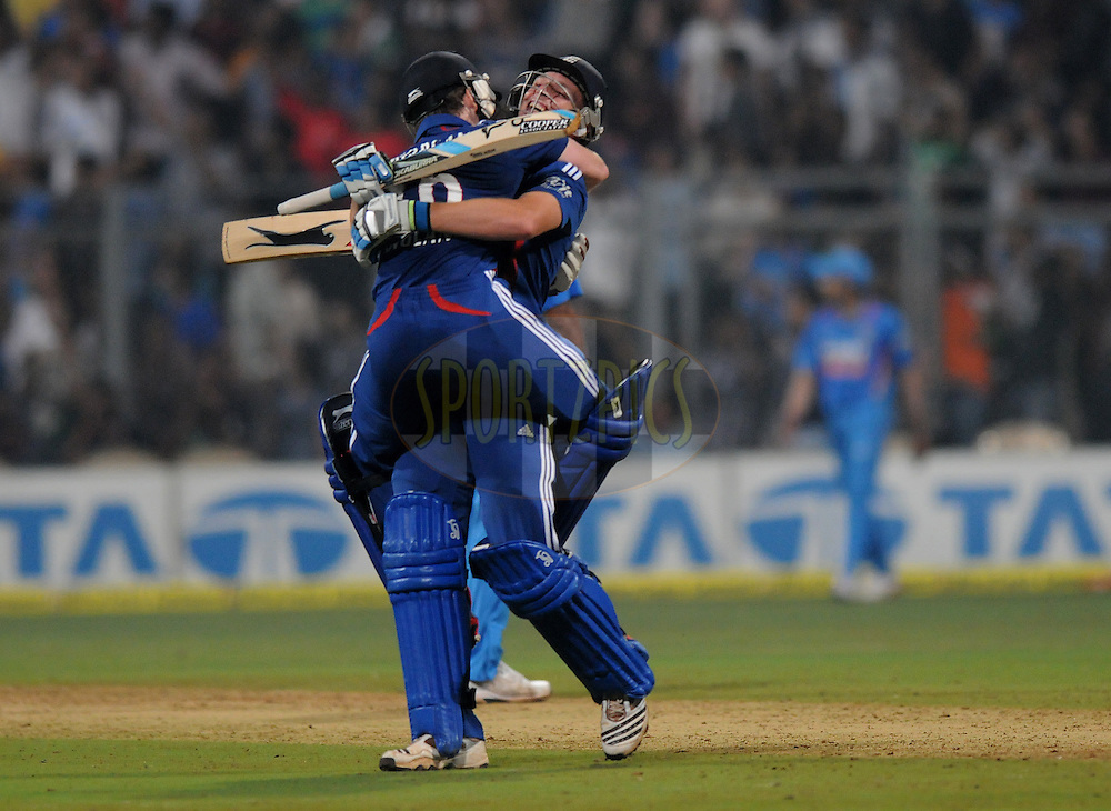 Jos Buttler of England and Eoin Morgan captain of England celebrate as they win the 2nd Airtel T20 Match between India and England held at The Wankhede Stadium in Mumbai on the 22nd December 2012..Photo by Pal PIllai/BCCI/SPORTZPICS ..Use of this image is subject to the terms and conditions as outlined by the BCCI. These terms can be found by following this link:..http://www.sportzpics.co.za/image/I0000SoRagM2cIEc