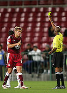 Thomas hicon accepts his yellow card from Victor Hlumgwana during the PSL match between Ajax Cape Town and Moroka Swallows held at Newlands Stadium in Cape Town, South Africa on 28 October 2009..Photo by Ron Gaunt/SPORTZPICS