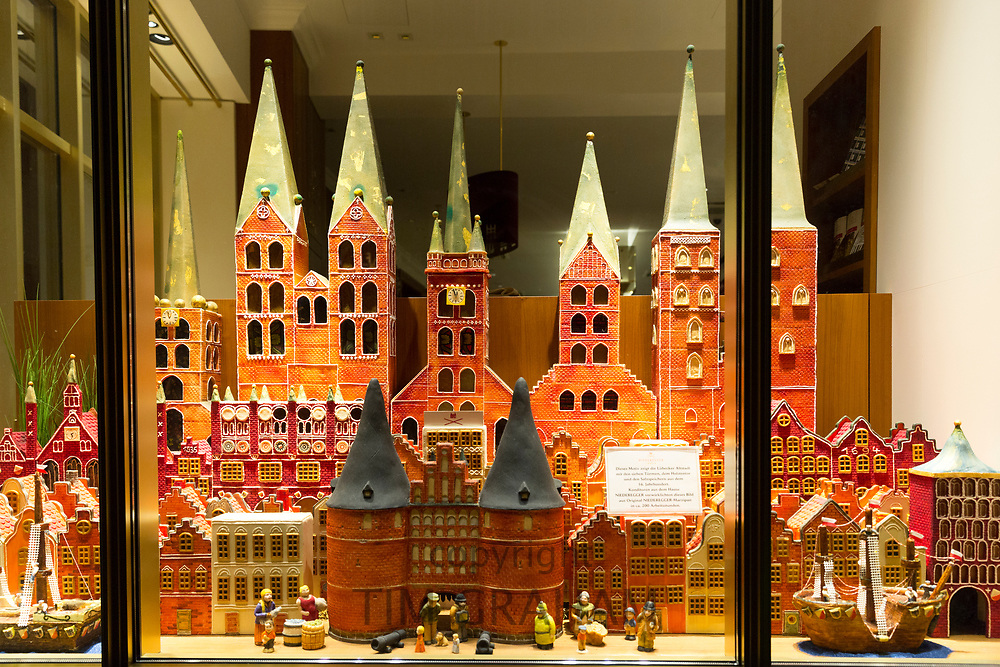 Houses and schloss castles of marzipan shop window display at J.G. Niederegger famous candy shop in Lubeck, Germany
