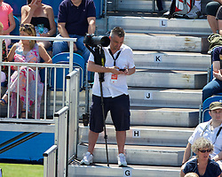 LIVERPOOL, ENGLAND - Saturday, June 21, 2014: Liverpool Echo photographer Jason Roberts during Day Three of the Liverpool Hope University International Tennis Tournament at Liverpool Cricket Club. (Pic by David Rawcliffe/Propaganda)