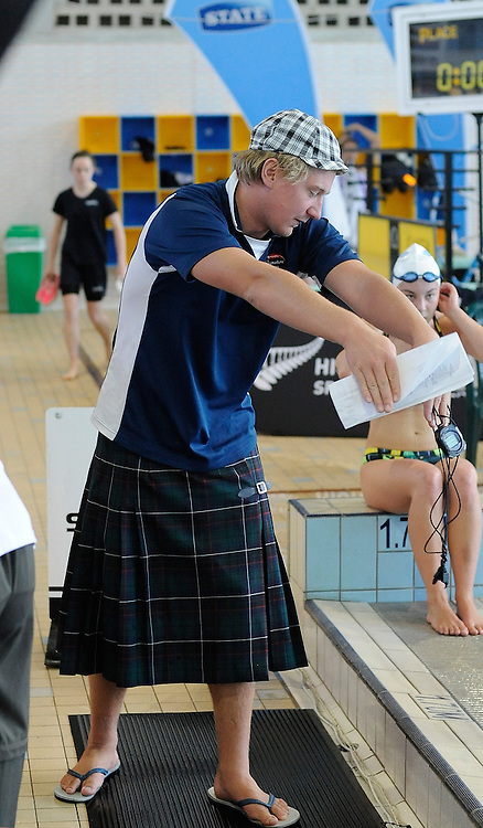 Coach gives out instruction, at the State New Zealand Division II Swimming Champs, at Moana pool, Dunedin, New Zealand. Friday 14 April 2012. Photo: Richard Hood photosport.co.nz