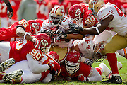 KANSAS CITY, MO - SEPTEMBER 26:   Frank Gore #21 of the San Francisco 49ers is tackled by the Kansas City Chiefs defense at Arrowhead Stadium on September 26, 2010 in Kansas City, Missouri.  The Chiefs defeated the 49ers 31-10.  (Photo by Wesley Hitt/Getty Images) *** Local Caption *** Frank Gore