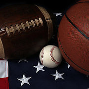 A studio shot of a Baseball, a Basketball and an American Football on a USA Stars and Stripes Flag. 20th October 2012. Photo Tim Clayton