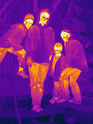 The different colors represent different temperatures on the object. The lightest colors are the hottest temperatures, while the darker colors represent a cooler temperature.  Thermography uses special cameras that can detect light in the far-infrared range of the electromagnetic spectrum (900?14,000 nanometers or 0.9?14 µm) and creates an  image of the objects temperature..