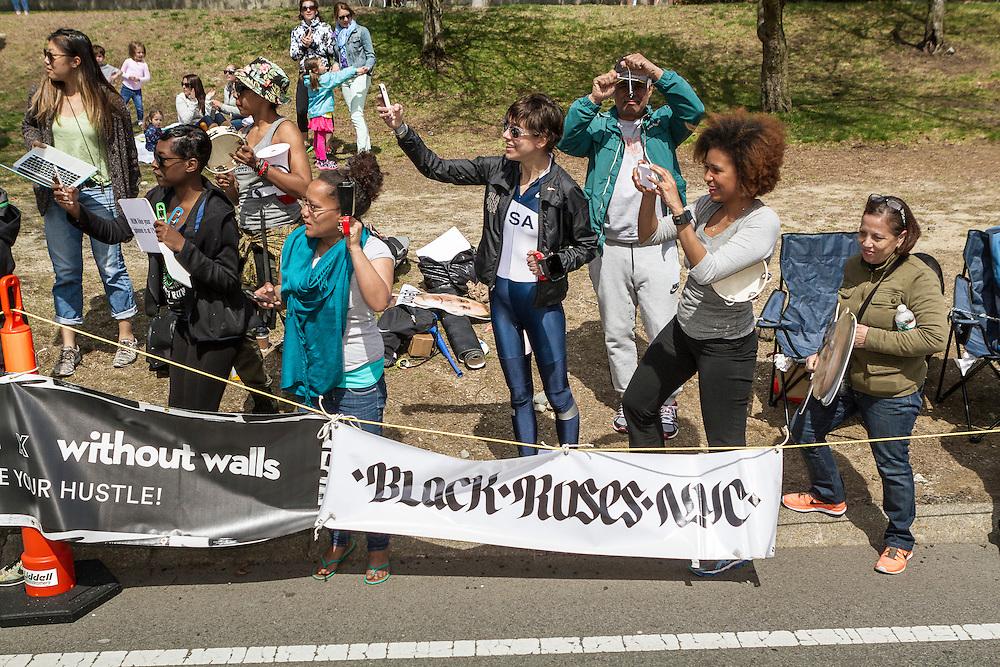 2014 Boston Marathon: spectators line race course to cheer passing runners