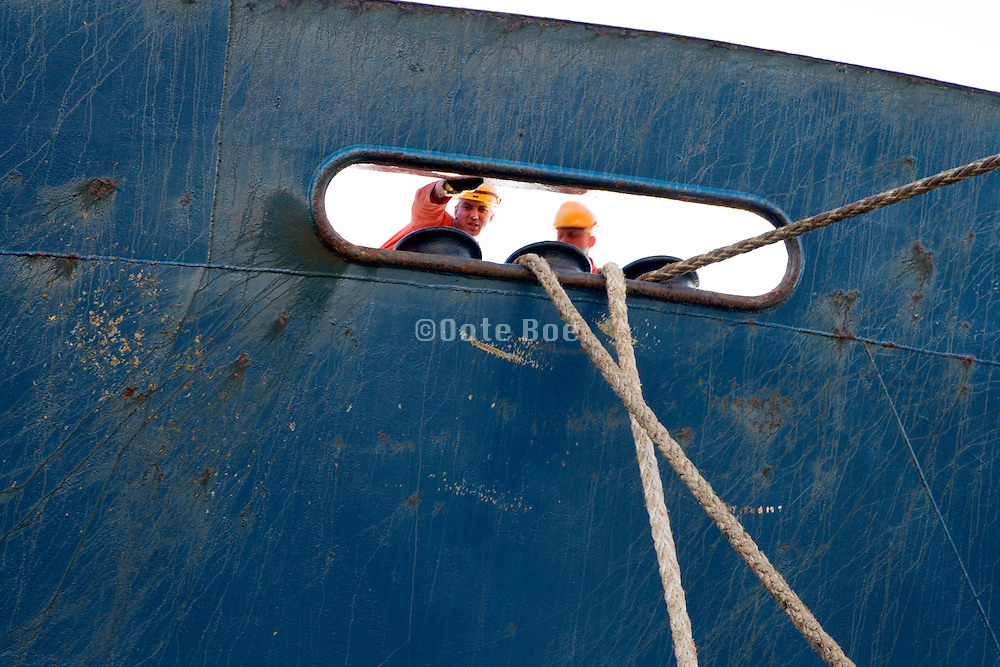 sailors anchoring a large ship