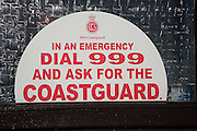 Coastguard emergency dial 999 sign