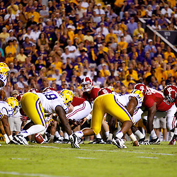 November 3, 2012; Baton Rouge, LA, USA;  Alabama Crimson Tide quarterback AJ McCarron (10) under center against the LSU Tigers during a game at Tiger Stadium. Alabama defeated LSU 21-17. Mandatory Credit: Derick E. Hingle-US PRESSWIRE