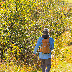 A young man walks a path on a hilltop field in Amesbury, Massachusetts.
